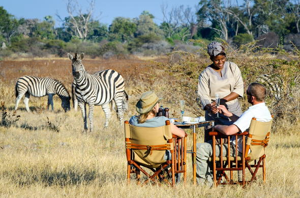 Dining in the bush during a Botswana luxury safari.