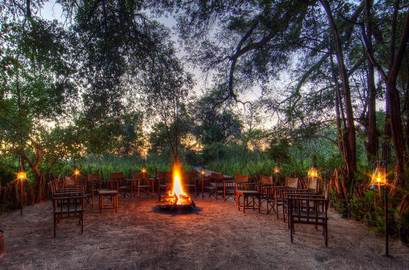 Spend your evenings around a roaring boma fire under the African sky.