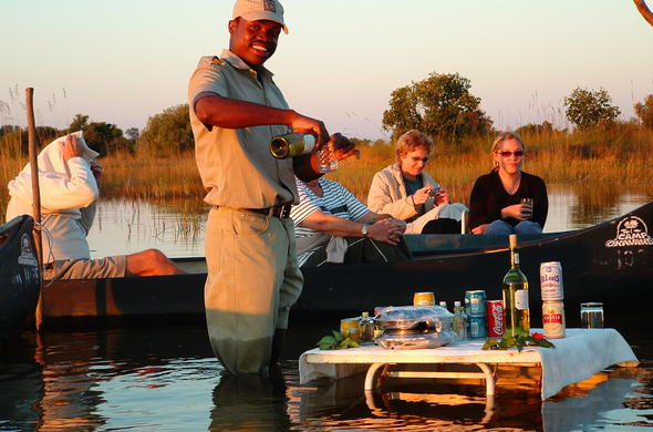 Guests enjoying sundowners at the Okavango Bar