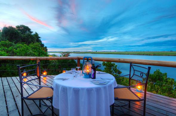 Romantic dinner by the river at Chobe Game Lodge