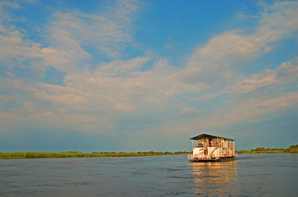 Enjoy a mobile safari on houseboat in the Okavango Panhandle.