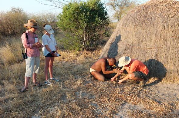 Kalahari San Bushmen teaching how to make a bow and arrow.