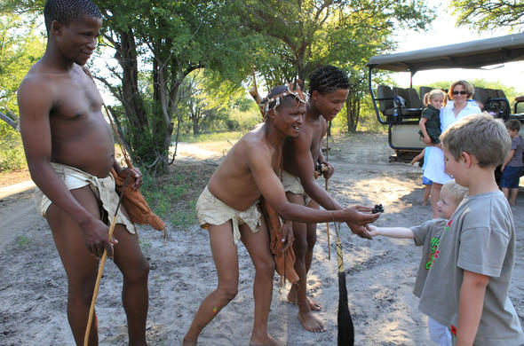 Bushmen welcoming your family to the Kalahari.