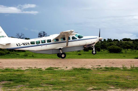 Light aircraft flight transfers you between camps and lodges in Botswana.