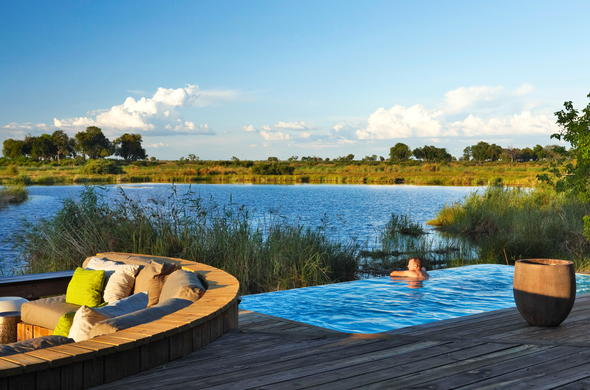 Luxury Botswana safari accommodation with pool and game viewing deck.