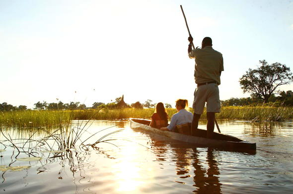 Romantic sunset mokoro canoe rides in the Okavango Delta.