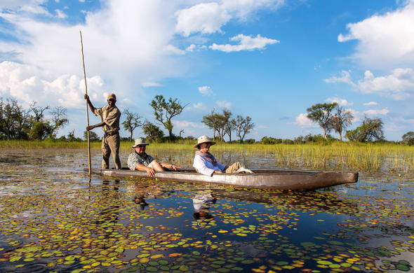 Traditional canoe mokoro safari in Okavango Delta.