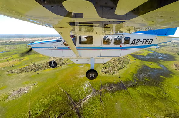 Flying over the Okavango Delta waterways in a light aircraft.