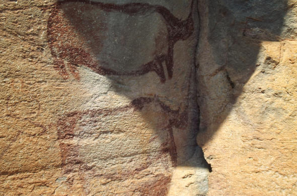Rhino, Rock-art at Tsodilo Hills. Michael English