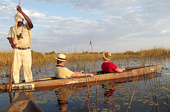 Crew Siyabona cruise the Okavango by makoro. Franco