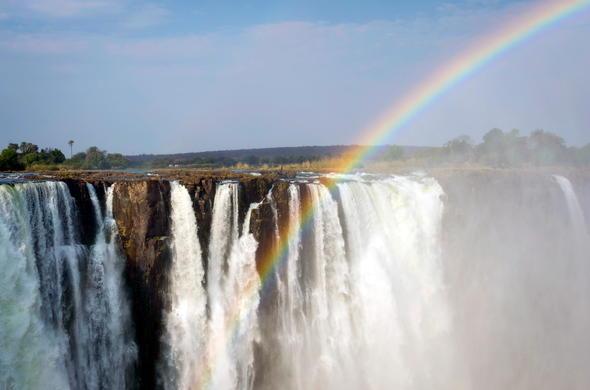 Rainbow over the Victoria Falls in Zambia.